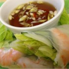 Nuoc Cham (Vietnamese Dipping Sauce) - This traditional Vietnamese dipping sauce is made with fish sauce, vinegar, lemon juice, garlic, and Thai chile peppers, the amounts of which can be adjusted to personal preference.