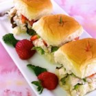 The Girls' Chicken Sandwiches - Chicken salad made with green onions and poppyseed dressing is served on sweet Hawaiian-style rolls spread with pineapple cream cheese and topped with fresh strawberries for a light and elegant springtime lunch.