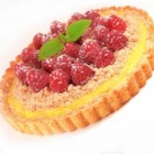 Raspberry Streusel Tart - A homemade custard is flavored with raspberry liqueur and baked in a tart shell, piled with raspberries, and studded with a fabulous sugar streusel.