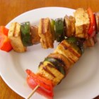 Grilled Tofu Skewers with Sriracha Sauce - Chunks of firm tofu are marinated with vegetables in a sauce made with sriracha, soy sauce, sesame oil, onion, and jalapeno.