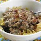 Marlene's Beef Stroganoff - Savory and tender flank steak bites in a creamy sauce with green peppers are served over hot cooked egg noodles.