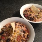 Moira Mitchell's Quick and Easy Taco Soup - This quick and easy taco soup is packed with black beans, corn, and salsa. Ladle it over your favorite tortilla chips and Mexican cheese.