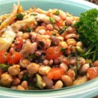 New Year Three-Bean and Artichoke Salad - Black-eyed peas add New Year flavor to this version of the three-bean salad that also includes Great Northern beans, garbanzo beans, and chopped artichoke hearts, with a balsamic, herb, and olive oil vinaigrette dressing.