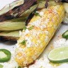 Mexican Corn on the Cob (Elote) - As served by street vendors in Mexico. Grilled ears of fresh corn are spread with mayonnaise and sprinkled with grated cotija cheese. You'll want to eat all your corn this way from now on.