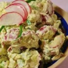 Mom's Dill Potato Salad - Seductively creamy with a sour cream-mayonnaise dressing, this skins-on red potato salad is seasoned with dried dill to distinguish it from the standard version.