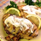Grilled Lemon Yogurt Chicken - This tangy lemon-yogurt chicken is grilled to caramelized perfection over a charcoal grill.