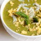 Asparagus, Lemon, and Mint Soup - Asparagus, mint, and lemon zest are simmered and pureed into a refreshing and easy soup topped with hard-boiled egg.