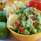 Yummy Guacamole - This refreshing guacamole has lots of lime juice, cilantro, and green onions for a dip everyone will love. Serve with tortilla chips or as topping for Mexican dishes.