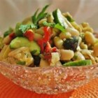 White Bean Salad - Cannellini beans, artichoke hearts, cucumbers, tomatoes, olives, and plenty of fresh herbs are tossed with a tangy sherry vinaigrette in this refreshing salad.