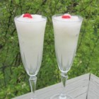 Frozen Daiquiri Cocktail - Frozen daiquiris are a great way to cool off on a hot summer day. Blend rum, sugar, triple sec, and lime juice together with ice for a frosty cocktail treat.