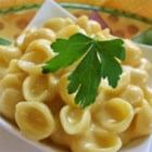 Microwave Macaroni and Cheese - Use your microwave to saute onions and butter before tossing the mixture with cooked pasta, milk and cubes of processed cheese. One more stint in the microwave will melt the cheese nicely, then you can season to taste.
