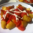 Authentic Patatas Bravas - Spanish tapas are tasty small plates that when combined can create a light supper or serve as a great appetizer. Patatas Bravas are tasty fried potato cubes served with a smoky, spicy dipping sauce.