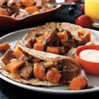 Beefy Sweet Potato Hash - Cooked beef and sweet potatoes make a savory-sweet hash with a Mexican-inspired flair, thanks to taco seasoning, cilantro, and a mildly spicy sour cream topping.
