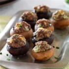 Beef and Blue Cheese Stuffed Mushrooms - Ground beef, blue cheese, and chives make a savory filling for stuffed mushrooms that are easy to make and will be a favorite appetizer at your next get-together.