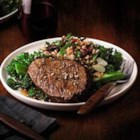 Beef Filets with Ancient Grain and Kale Salad - Broiled beef tenderloins are served alongside a warm farro salad with dried cranberries and kale for an elegant dish that's fancy enough for a special occasion for two.
