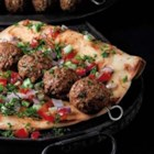 Mediterranean Beef Meatball Kabob - Seasoned baked meatballs broiled on skewers are served in flatbreads with optional Mediterranean toppings like chopped cucumber or tzatziki sauce for a quick lunch.