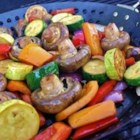 Marinated Veggies - Zucchini, red and yellow peppers, mushrooms, yellow squash, and cherry tomatoes are marinated in a lemon-soy marinade and grilled.