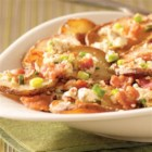 Pan-Fried Greek Potatoes - Thinly sliced potatoes are pan fried in bacon drippings, and served with crumbled bacon, sliced green onions, and lots of feta cheese with basil and tomato.