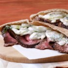 Grilled Steak with Tzatziki Salad - Marinate a sirloin steak in a zesty sauce, grill it your way, slice and top with more sauce. Serve steak slices in pitas with tzatziki sauce with lots of crumbled feta cheese.