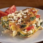 Greek Omelet with Feta - Spinach, red onions, garlic, and tomatoes are cooked into this omelet, then it's topped with crumbled feta cheese for a delicious breakfast or brunch.