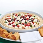 5-Layer Greek Dip - Dip right in! This bright Mediterranean combo brings smarts to snacking. Authentic Greek flavors, from kalamata olives to feta, make for a deliciously fresh-tasting app.
