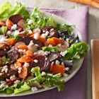 Roasted Beet and Carrot Salad - Roasted beets and carrots are served on mixed salad greens with balsamic vinaigrette and topped with sliced radishes and crumbled feta cheese.