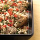Easy Feta Chicken Bake from ATHENOS - Chicken breasts are baked with feta cheese and lemon juice, then sprinkled with fresh parsley and chopped red bell pepper before serving.