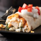 Greek-Style Burritos - Chicken burritos with rice, lemon zest, hummus and spinach are a tasty variation on traditional flavors and ingredients.