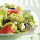 Greek Feta Salad from ATHENOS - This classic Greek salad combines cucumbers, tomatoes, kalamata olives, and crumbled feta cheese.