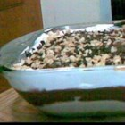 Jimmy Carter Dessert - This is a rich layered dessert made in a large 9x12-inch baking pan. A buttery graham cracker crust holds a layer of peanut butter and cream cheese that 's followed by a yummy layer of vanilla and chocolate pudding. And finally, whipped topping, chopped peanuts and shaved chocolate crown the top.