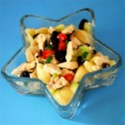 Chicken and Vegetable Pasta Salad - Choose a pretty pasta  - bow tie, penne or rotini. That 's half the fun in making this salad. A nice Italian dressing adds plenty of zip, and the only thing left is tossing in the chicken, green onions, olives and a few cucumbers.