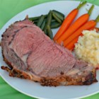 Prime Rib - It's Easier Than You Think - Prime rib with a little steak seasoning, garlic, and a good thermometer are the fool-proof ingredients to making a memorable, formal dinner party main dish.