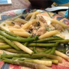 Chicken Asparagus Pasta with Cream Sauce - This quick and easy pasta is tossed with chicken and homemade cream sauce. Asparagus and Parmesan cheese add a nice color and flavor.