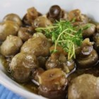 Baked Mushrooms with Thyme and White Wine - Baked in a mixture of garlic, white wine and thyme, these mushrooms are a great topping for grilled steak or baked potatoes, but also make for an excellent side dish.