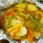 Fantastic Grilled Potatoes - Seasoned, sliced potatoes, and bell peppers are wrapped in foil and cooked on the grill in this tasty side dish.
