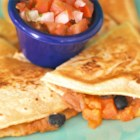 Vegan Black Bean Quesadillas - These vegan black bean quesadillas replace the traditional cheese filling with pureed great Northern beans, nutritional yeast, and lots of spices for a tasty Mexican-inspired meal.