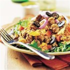 Confetti Beef Taco Salad - A colorful taco salad with ground beef, tortilla chips, salad greens, shredded cheese, and lots of optional toppings is a sure-fire family favorite.
