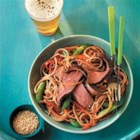 Grilled Steak and Asian Noodle Salad - A beef salad done Asian-style has whole-grain noodles, colorful sugar snap peas, red bell peppers, and carrots tossed in a light sesame-lime dressing.