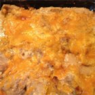 Momma Moots' Pork and Pierogies Casserole - Fresh rosemary flavors this creamy casserole of cubed pork, sweet corn, and pierogies.
