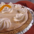Quick and Easy Peach Cheesecake - This delightful cheesecake combines cream cheese, peach preserves, and whipped topping for a quick and easy dessert.