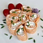 Burrito Canapes - Tortillas are rolled around a spicy cream cheese filling and sliced into small rounds for a fun and easy appetizer.