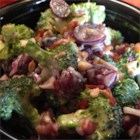 Broccoli Salad with Red Grapes, Bacon, and Sunflower Seeds - Traditional broccoli salad with the addition of red grapes, bacon, and sunflower seeds is a nice combination of sweet and savory and perfect for summer picnics.