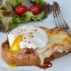 Chef John's Monte Cristo Benedict - Pan-fried French toast forms the basis for a delectable brunch main dish when topped with ham, two kinds of cheese, and perfectly poached eggs for a twist on the Monte Cristo sandwich.