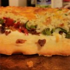 Jalapeno Popper Pizza - A prepared pizza crust is topped with ranch flavored cream cheese, jalapeno slices, bacon pieces, and shredded cheese then baked until golden brown.