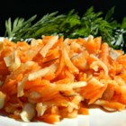 Carrot Salad - Almonds take the place of raisins in this one, and apples are also featured.  Lemon juice and a big dollop of honey make this a sweet, sweet salad. Serve chilled.