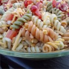 Home Town Drive-In Pasta Salad  - A homemade sweet and tangy dressing brings the flavor to a pretty pasta salad made with sharp Cheddar cheese, colorful spiral pasta, and red bell pepper.