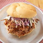 BBQ Pulled Pork Sandwiches - Slow cooking makes for a tender, flavorful pulled pork and, served on kaiser rolls and topped with creamy cole slaw, it will feed a happy, hungry crowd.
