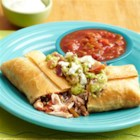 Chicken Chimichangas with Chunky Guacamole - Tortillas are filled with shredded chicken, black beans, salsa, and cilantro and quickly fried until golden brown. Serve with your favorite toppings including fresh, chunky guacamole.
