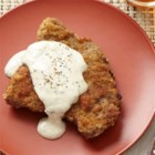 Chicken Fried Steak with Cream Gravy - Top round steak is pounded thin, dredged in bread crumbs, then pan fried until browned. Served with creamy gravy, this is comfort food at its finest.