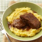 Country Beef Short Ribs and Rosemary Polenta - Browned then slowly braised in red wine, falling-off-the-bone short ribs are served with creamy, cheesy polenta seasoned with rosemary.